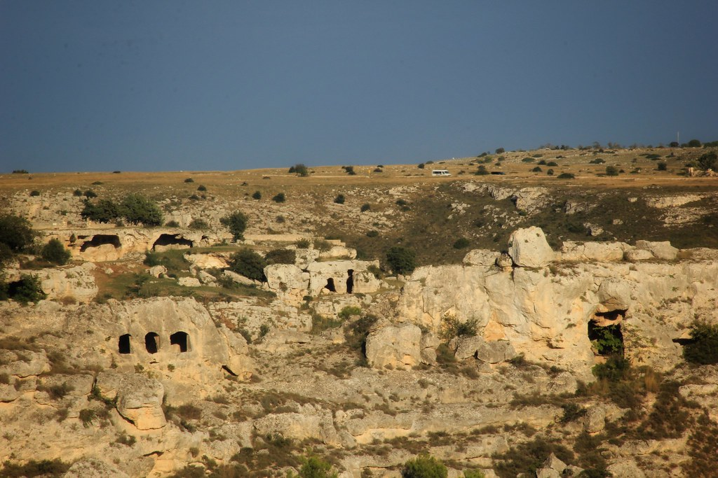 Hillside punctuated with small caves, Matera