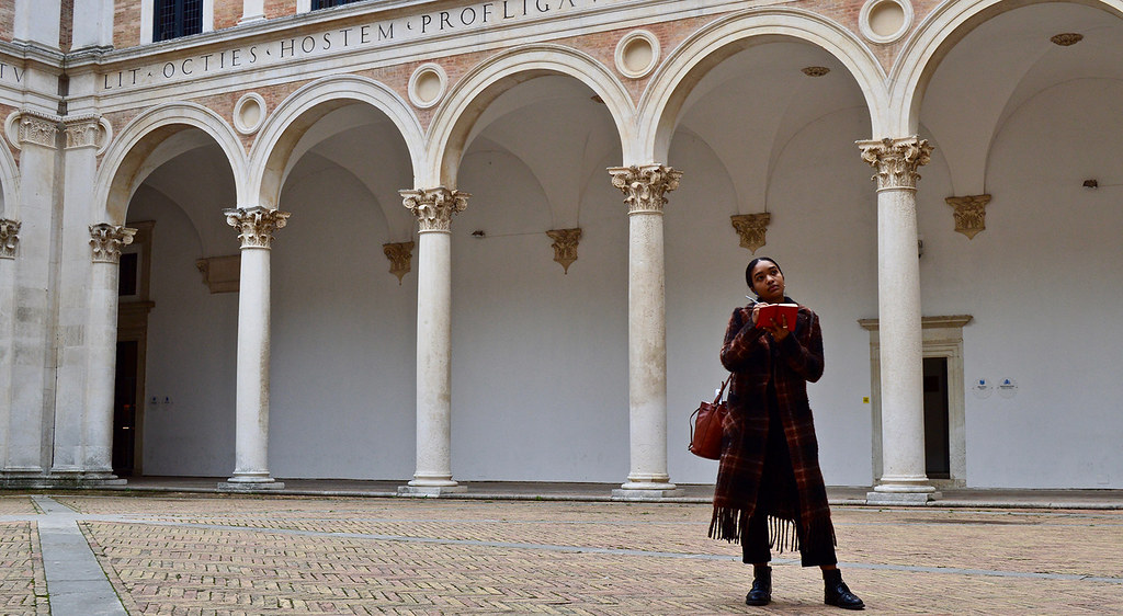 Jordan Kelly (B.F.A. '20) sketches the courtyard of the Palazzo Ducale in Urbino during a field trip for Cornell in Rome.  photo / Alp Demiroglu (B.Arch. '21)