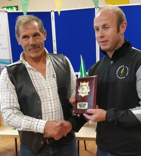 Chair BME Handball Club, Gerry McGrath presents to double medal world winner Myles Carroll, who has since claimed  an Irish Leinster singles title