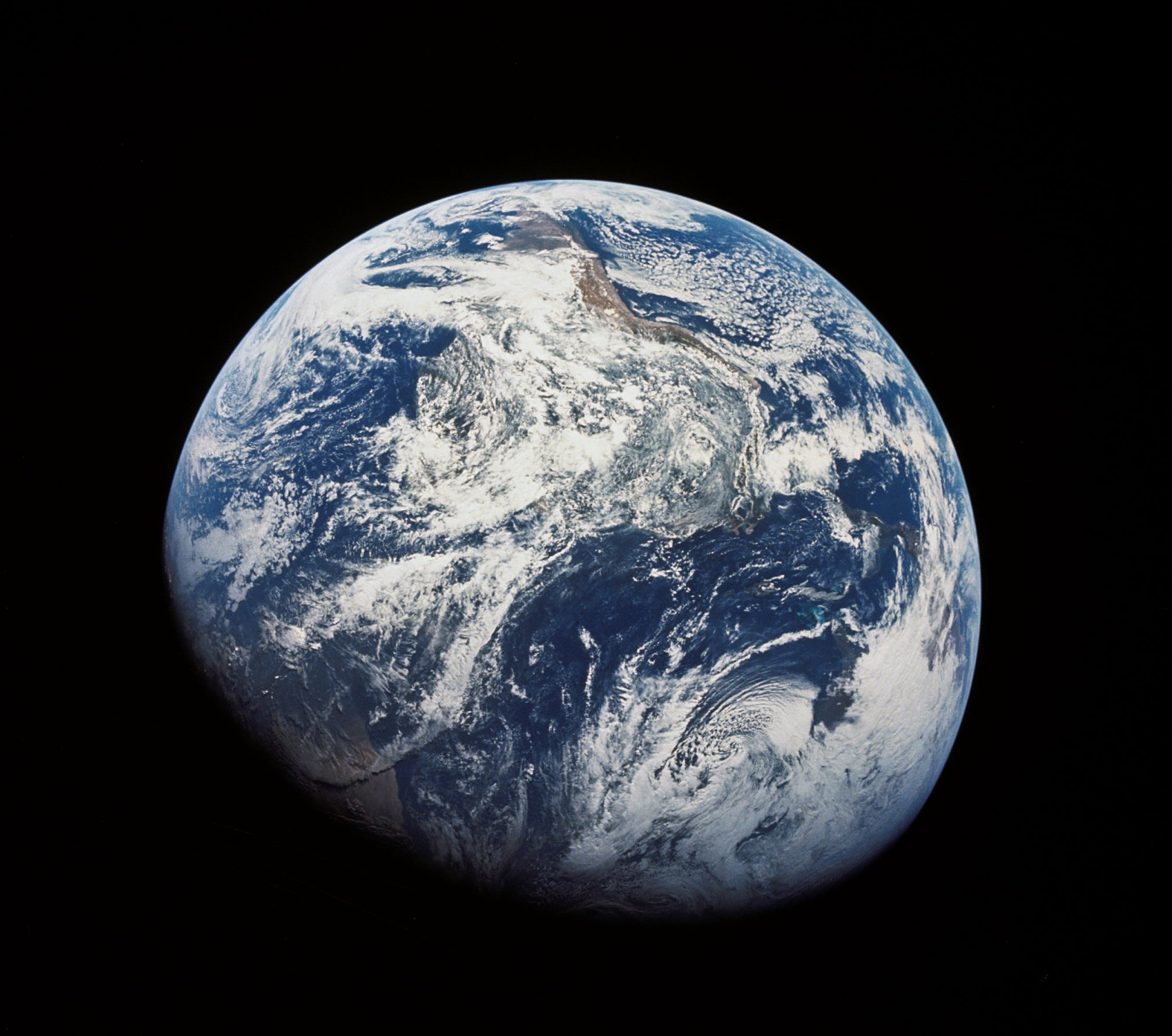 The first image ever taken by humans of the whole Earth, probably photographed by William Anders. The photo shows the Earth at a distance of about 30,000 km. South is at the top, with South America visible at the covering the top half center, with Africa entering into shadow. North America is in the bottom right.