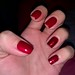 Nails Inc Christmas set- metallic red is Shake Your Baubles & Glitter red is Get the Party Started.