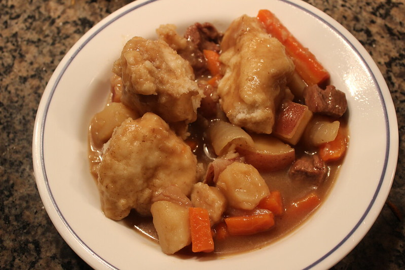 bowl of stew and dumplings