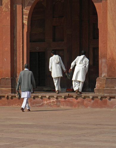 Three men entering the mosque at Fatehpur Sikri, India