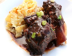 Beef Ribs Braised With Blueberries And Merlot. Served With Mafaldine & Pangrattato