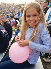 Violet Tying A Balloon At The Sheryl Crow Concert