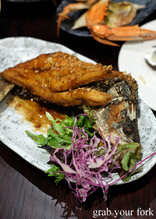 Deep fried whole barramundi with garlic at Talay's Thai all you can eat seafood buffet at Duo Central Park in Chippendale