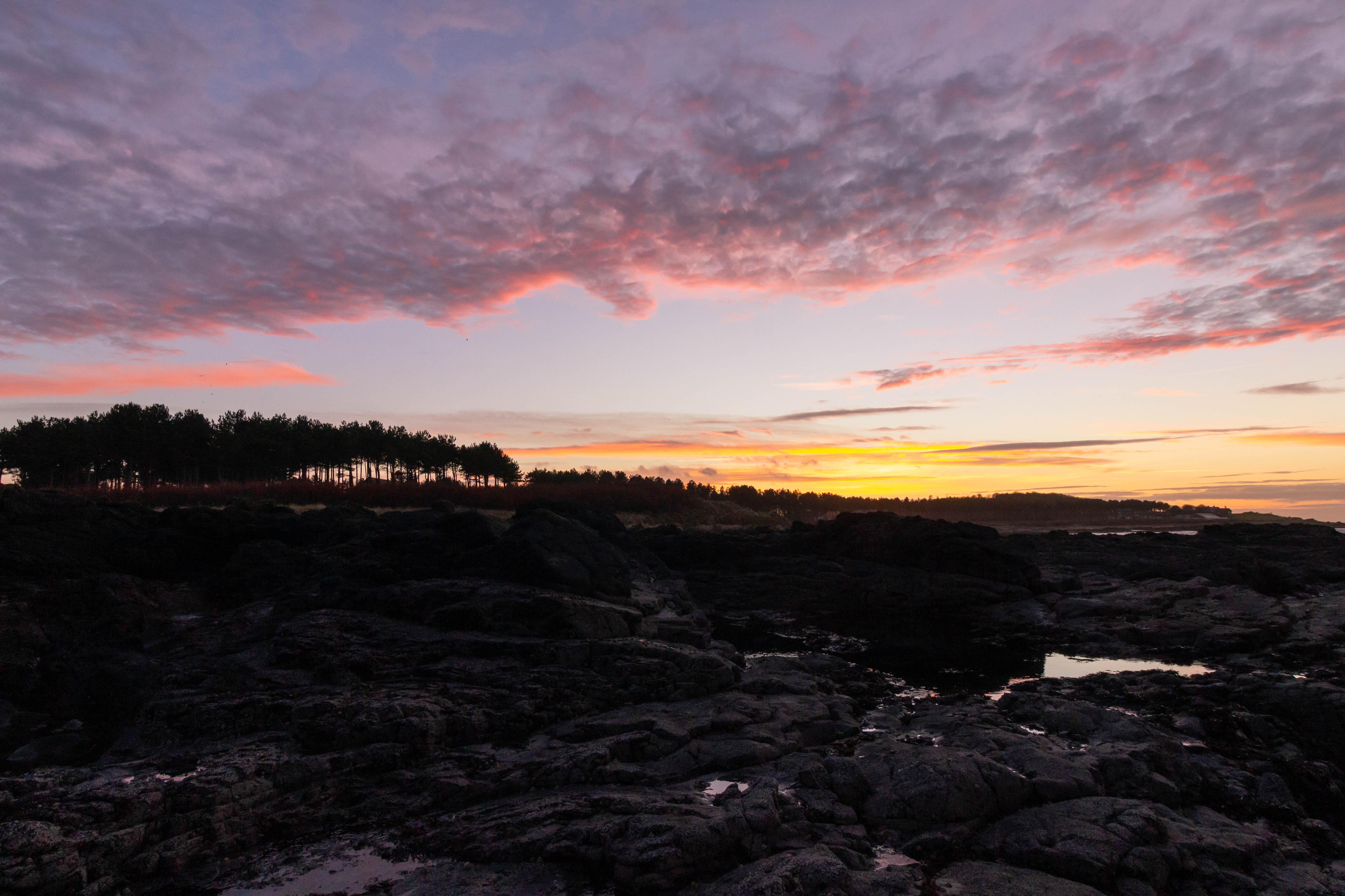 Beautiful orange, pink, and purple sunset at Yellowcraig Beach, East Lothian